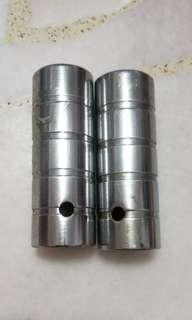 A pair of front  foot pegs