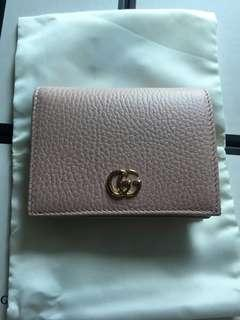 Pink Gucci wallet with receipt