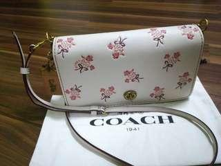 Coach crossbody Dinky with floral bow print