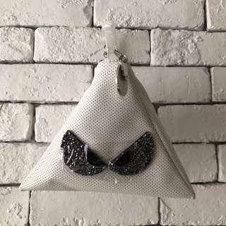 Millie's triangular white handbag