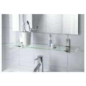 Glass wall shelf with stainless steel brackets