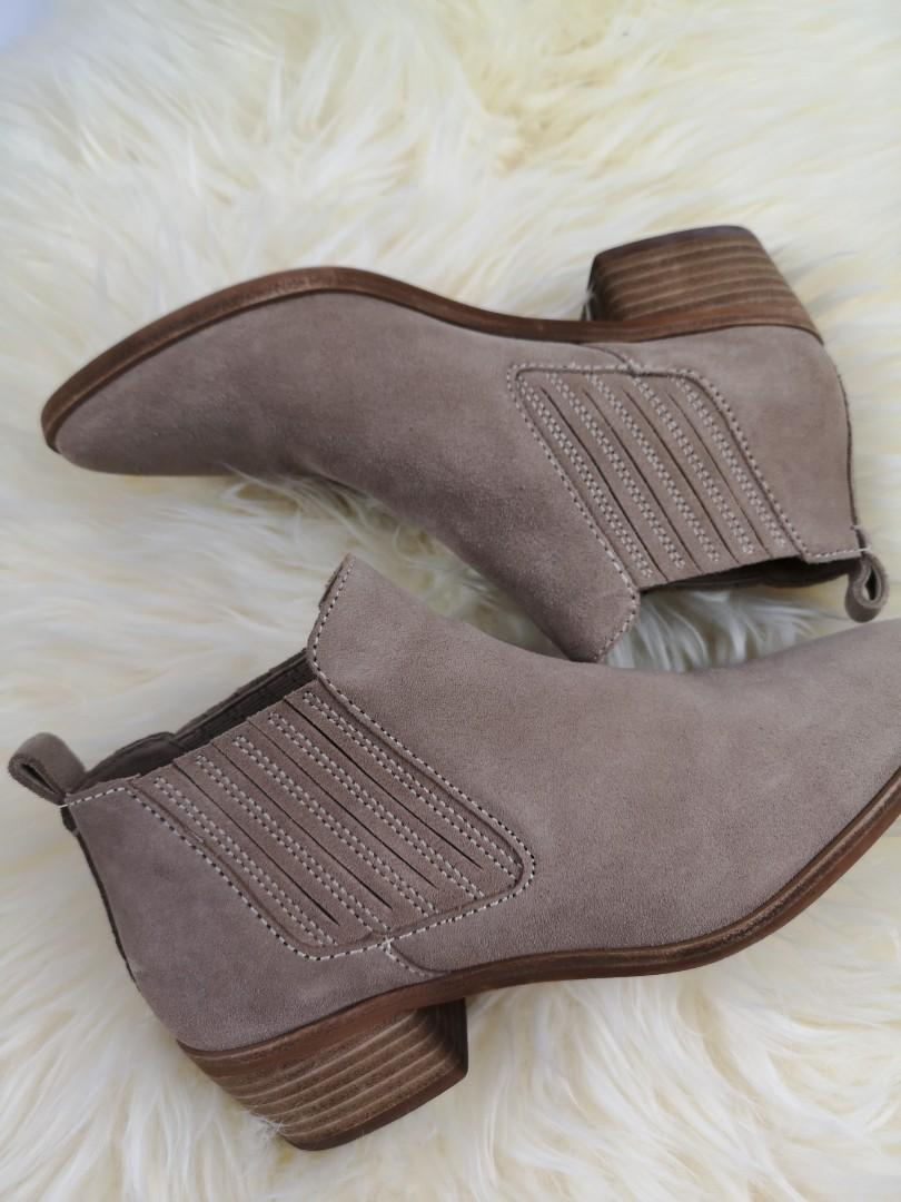 Dolce Vita suede booties purchased at Nordstrom for $130 plus gst. Lightly worn no stains on suede. They fit size 7- 7.5 (10 inches from heel to toe). Perfect everyday pair of booties.