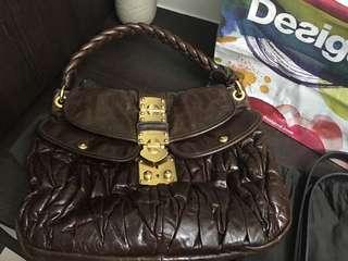 Miu Miu dark chocolate coffer bag 047beeee8a60f
