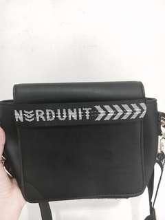 Emblem sling bag