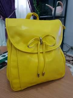 Yellow bag- sling to backpack