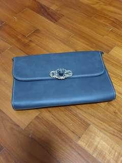 Grey clutch with jewel buckle