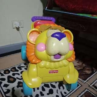 Fisher price lion car/walker
