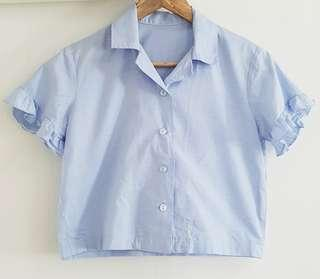 Light blue buttondown shirt with ruffled sleeves
