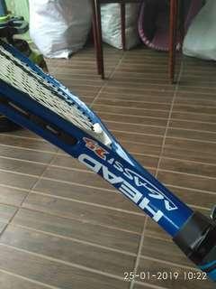Raket tenis merek HEAD