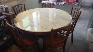Round marble table with chairs