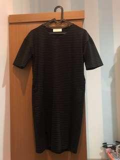 Mini black dress.