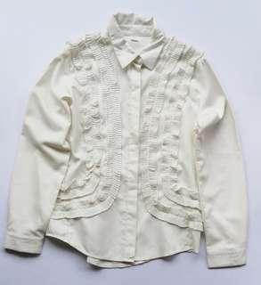 White longsleeves with ruffled details
