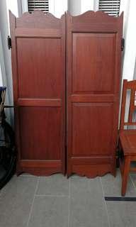 A pair of swing door