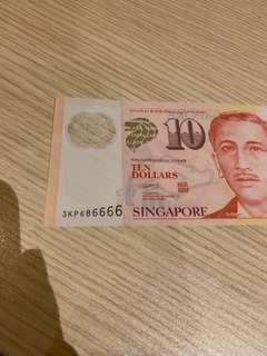$10 note with serial number 686666