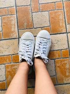 Cotton on white canvas shoes