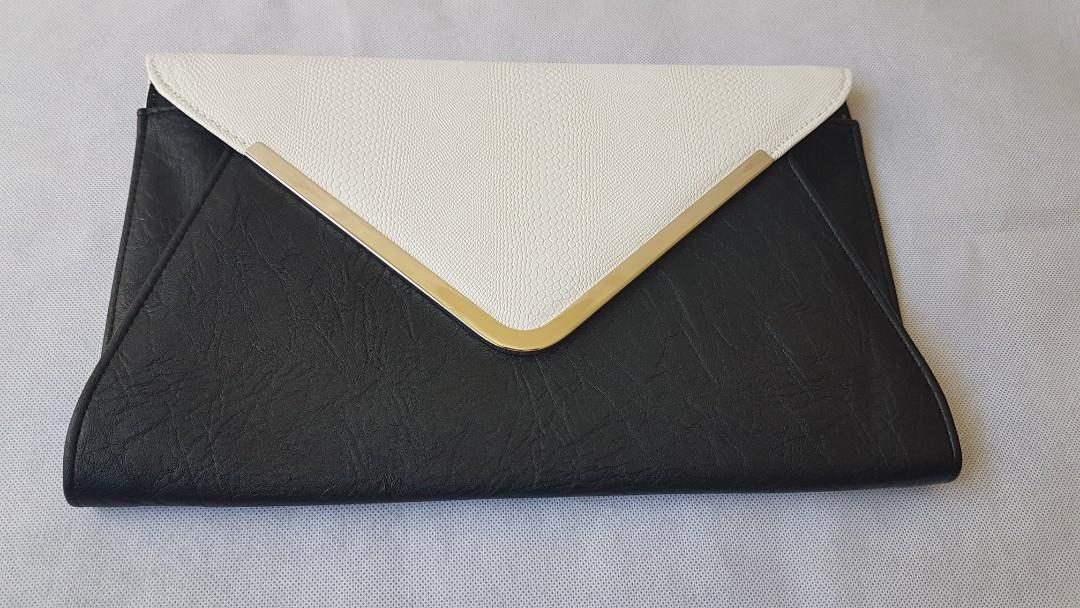 Colette black and white faux snakeskin print look envelope clutch bag