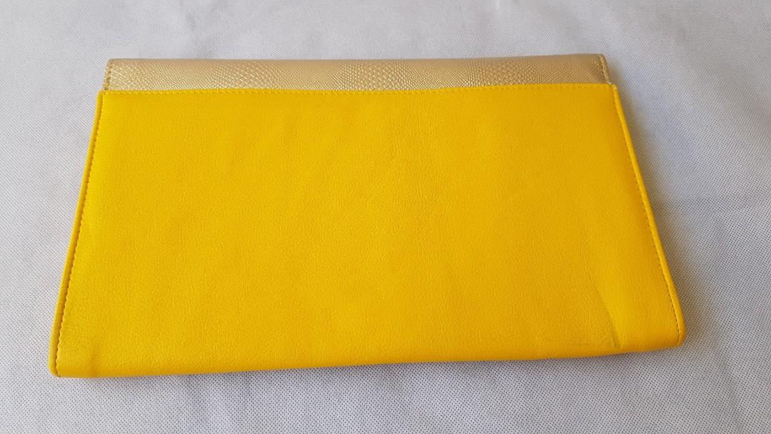 Colette yellow faux snakeskin look envelope clutch bag