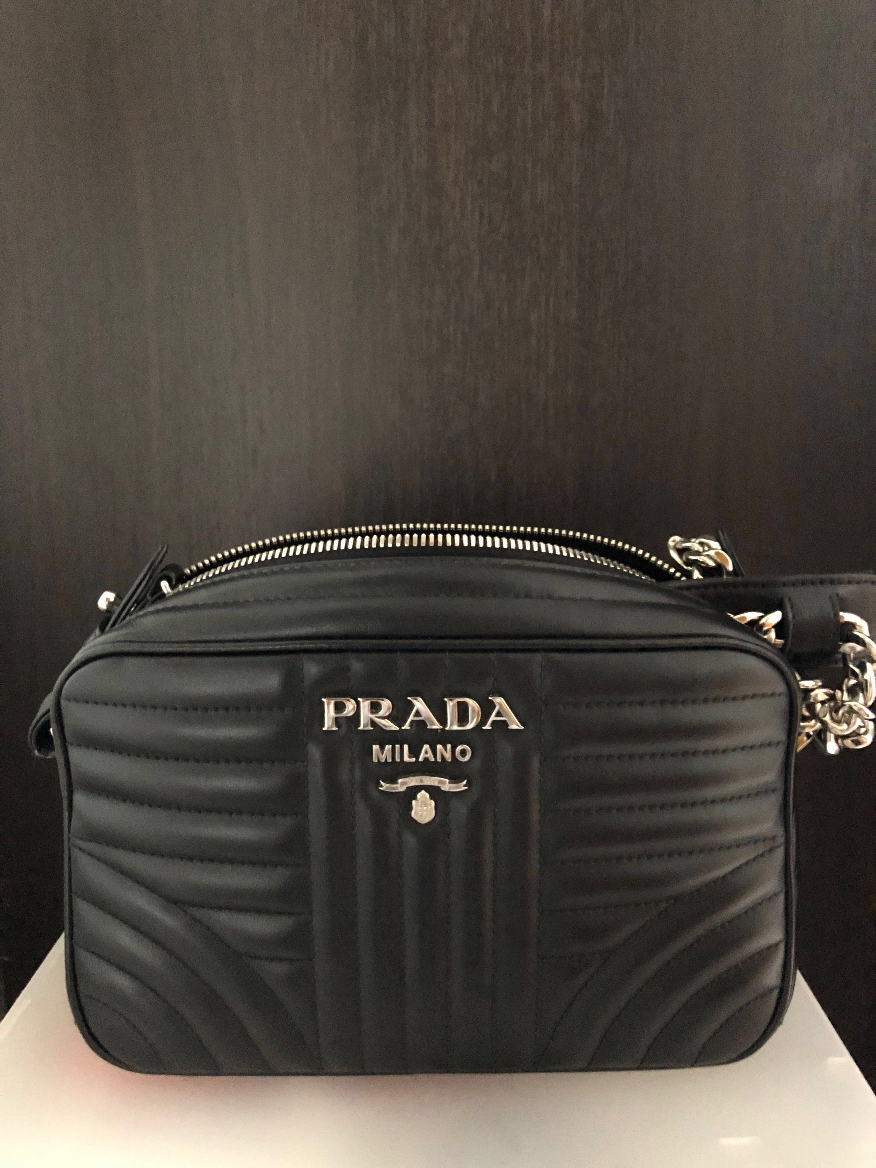 e122441a018a Prada Bag Diagramme camera bag, Luxury, Bags & Wallets, Sling Bags on  Carousell