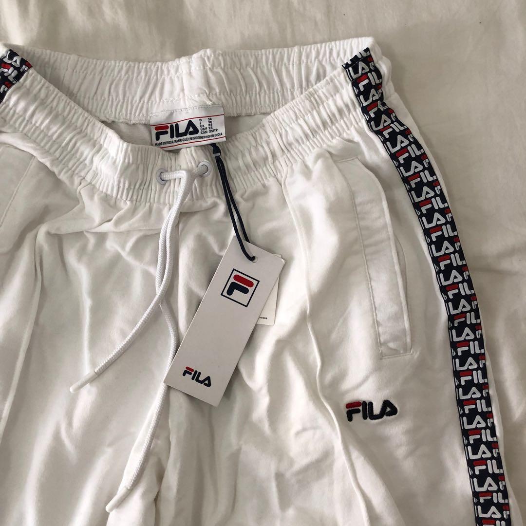 ca042e758b1d urban outfitters fila lara logo stripe track pants, Women's Fashion ...
