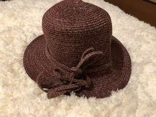 Topi pantai coklat (bali)