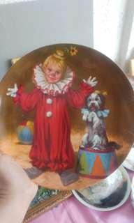 Dog and clown decorative plate