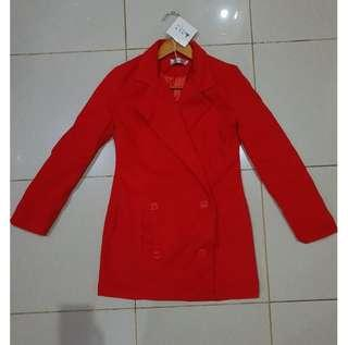 Red coat with tag