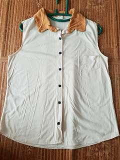 Brown sleevelss topnwith front button