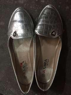 Silver colored shoes