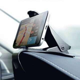 Mobile phone holder on dashboard meter