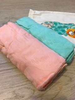Brand new unrolled Tula Tulaceratops Blanket in Pink and Mint