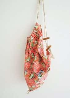 graphic pink sling bag