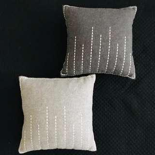 Grey felt cushions (with embroidery details) x 2