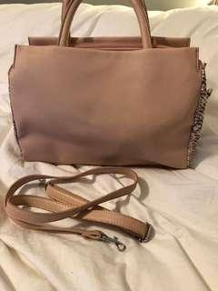Light blush purse with snake skin sides.  Comes with cross body strap. Barely used