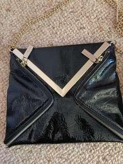 Wayne cooper black and gold bag