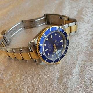 Rolex submariner 18k yellow gold 16613