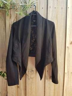 L VS H black jacket with black lace insert on back. Size XS