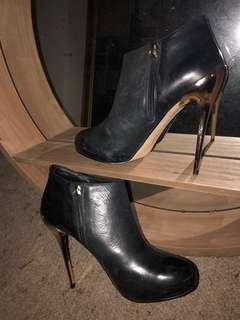 Black, gold high heel boots