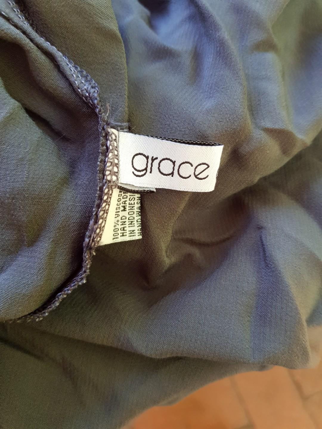 Grace of favour green cardigan with hole detail. Size 8.