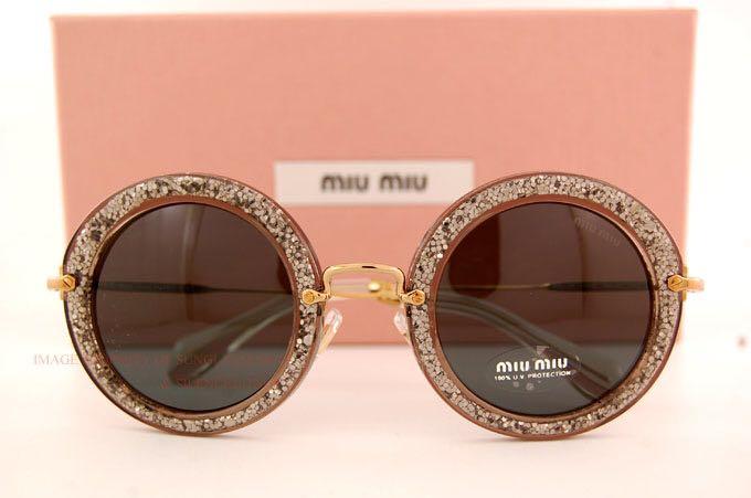 e4f13fc83b890 Miu Miu Round Women s Sunglasses - Smoke Glitter Silver