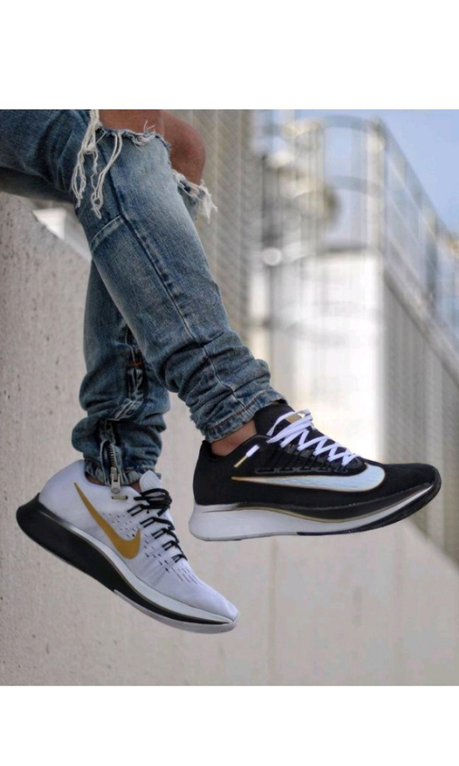 "e6a5c2b30d4e Nike Zoom Fly Mismatched ""Black Metallic Gold White"""