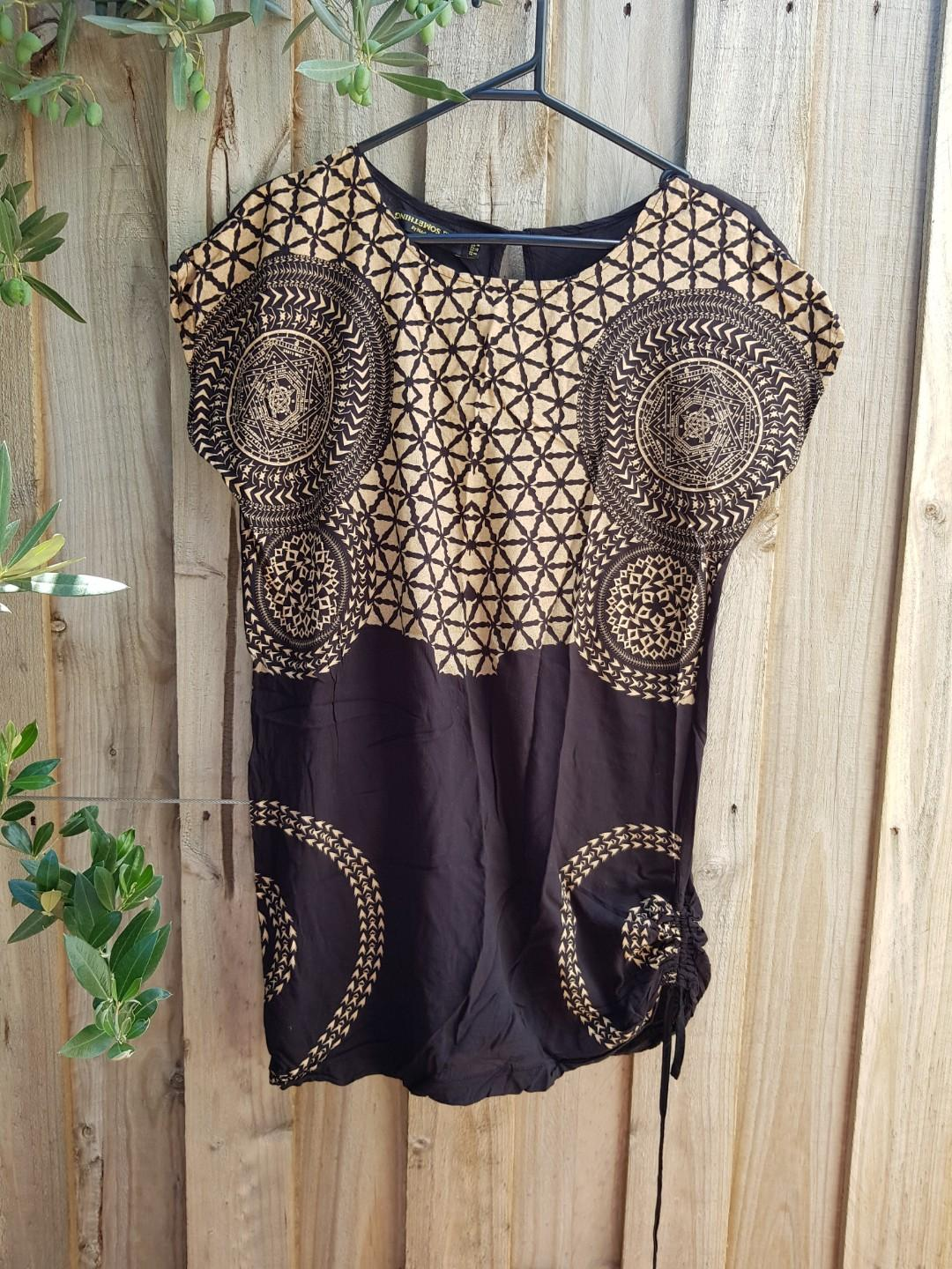 Something Else long black and gold top. Gathered at one side.