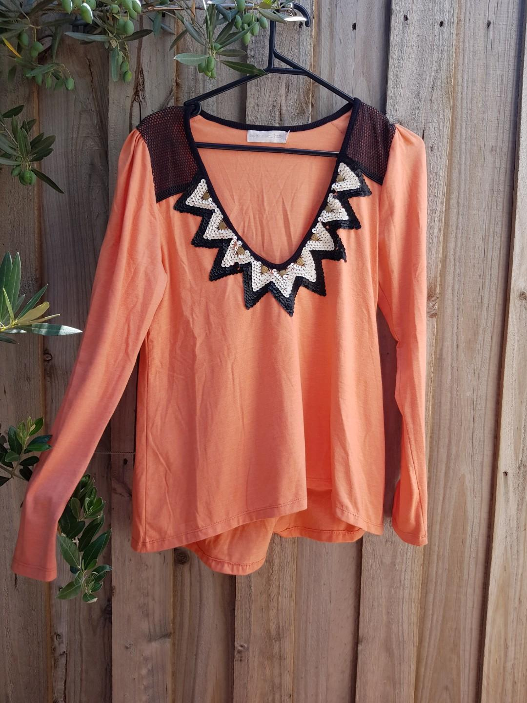 THE SHANTI BUTTERFLY orange top with sequin detail. Size 6-8