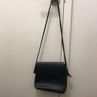 Black snap button crossbody bag