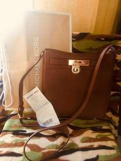 Mk Jetsetter sling bag. 💯original from 🇺🇸outlet. Complete po with gift receipt tag price care card and paper bag! Money back IF proven FAKE!! Sale Price!!
