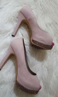 Pink peeptoe heels
