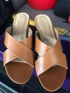 Tan leather slip ons
