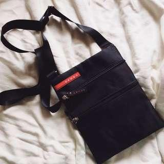 Compact Multi-Compartment Sling Bag.