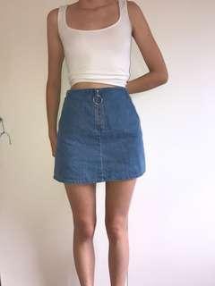 Subtitled zip up denim skirt