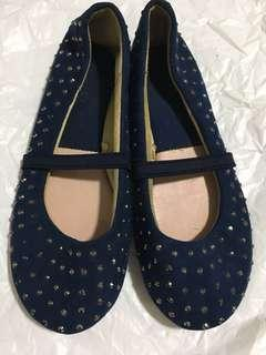 Glitter dot covered shoes for toddler