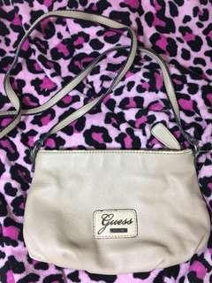 BEIGE GUESS SLING BAG